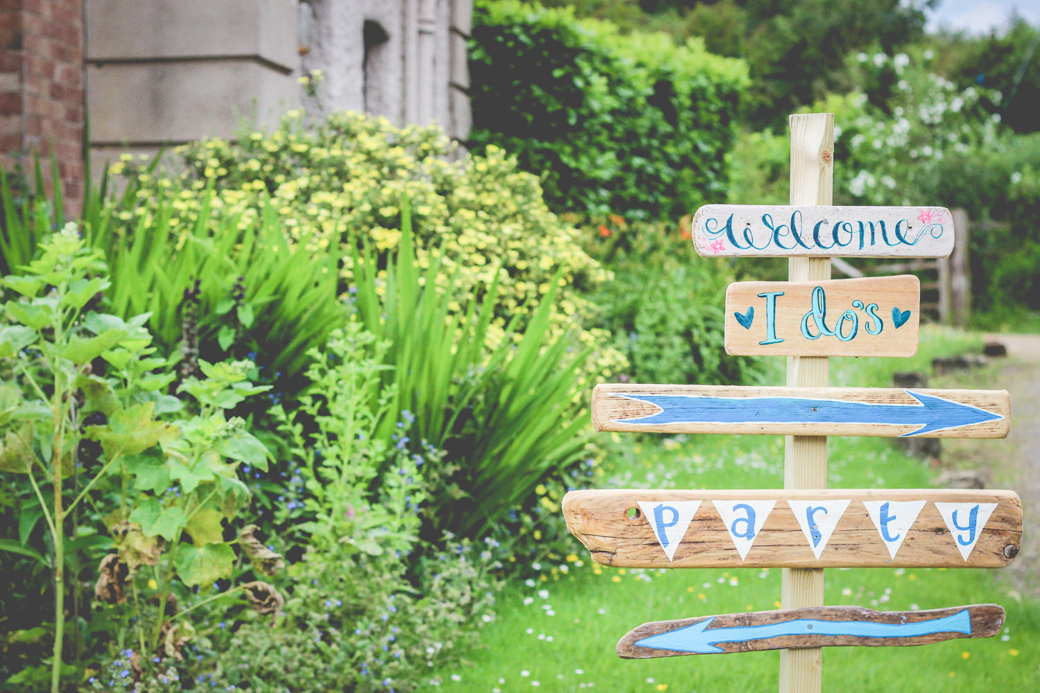 Rustic DIY wedding sign at Talton Lodge Wedding