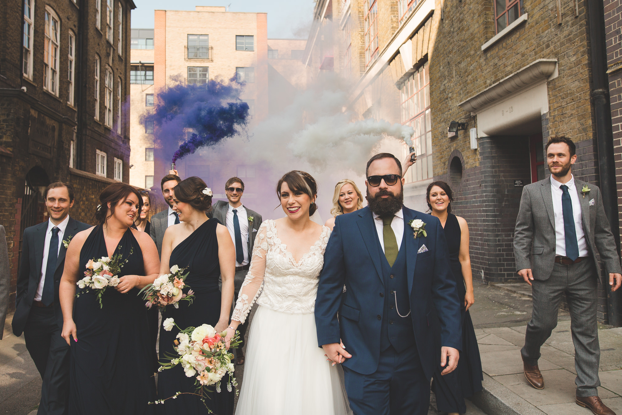 Colourful fun smoke bomb of wedding party by Ace Hotel in Shoreditch, London.