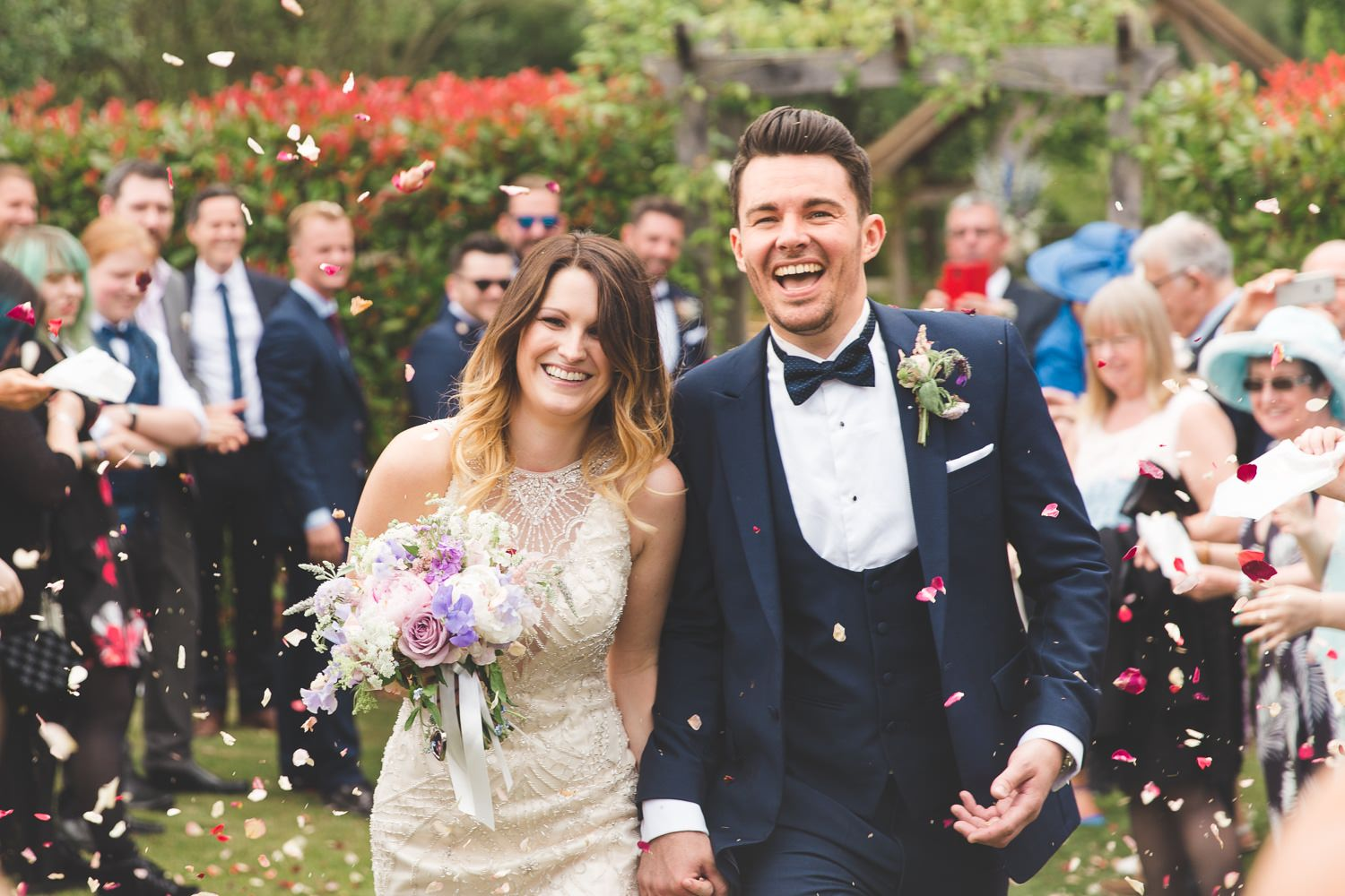 Country confetti with bride and groom at Millbridge Court wedding