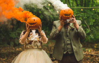 Halloween inspired wedding photography with pumpkins and orange smoke grenades at the Dreys Wedding Venue in Kent