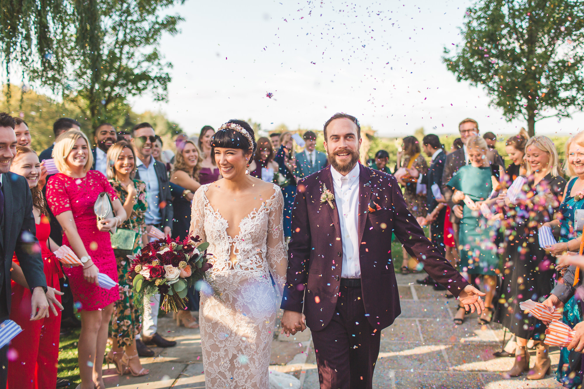 Colourful alternative fun confetti shot at Cain manor wedding