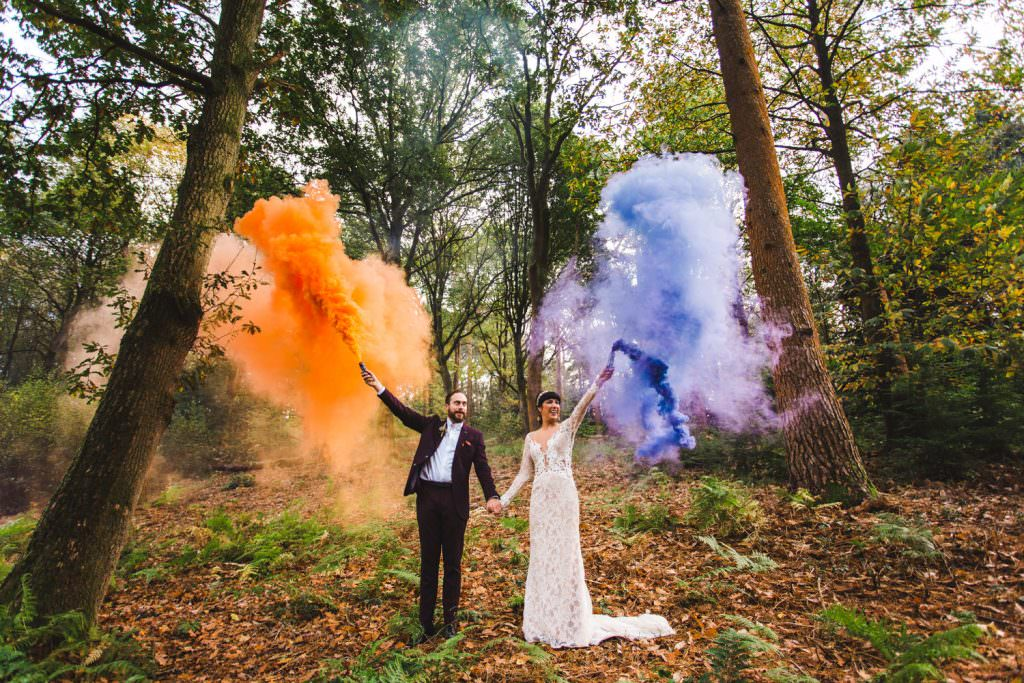bride and groom with orange and purple smoke bombs during Alternative Cain Manor Wedding Photography