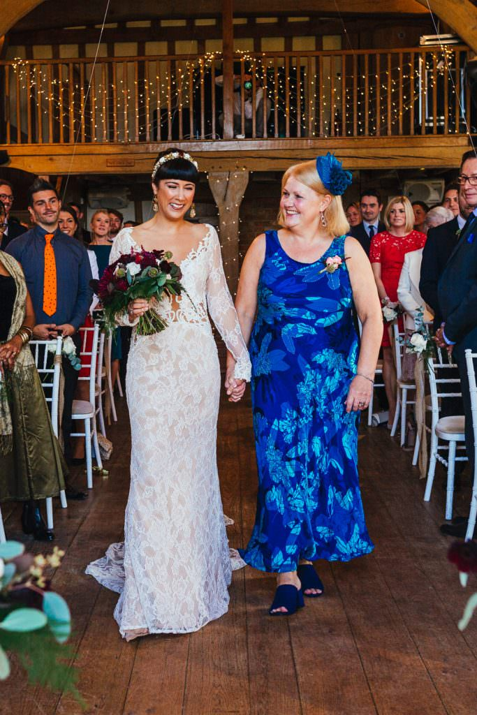 Mother of the bride walking her daughter down the aisle during Cain Manor Wedding Photography
