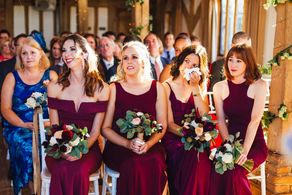 emotional bridesmaids during a wedding ceremony at Cain Manor. Natural and quirk wedding photographs during Cain Manor Wedding Photography