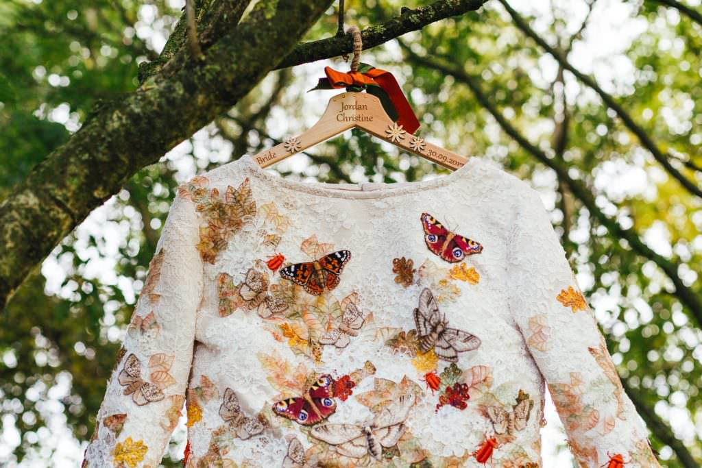 Alternative wedding dress with butterflies and Beatles on at the dreys wedding photography