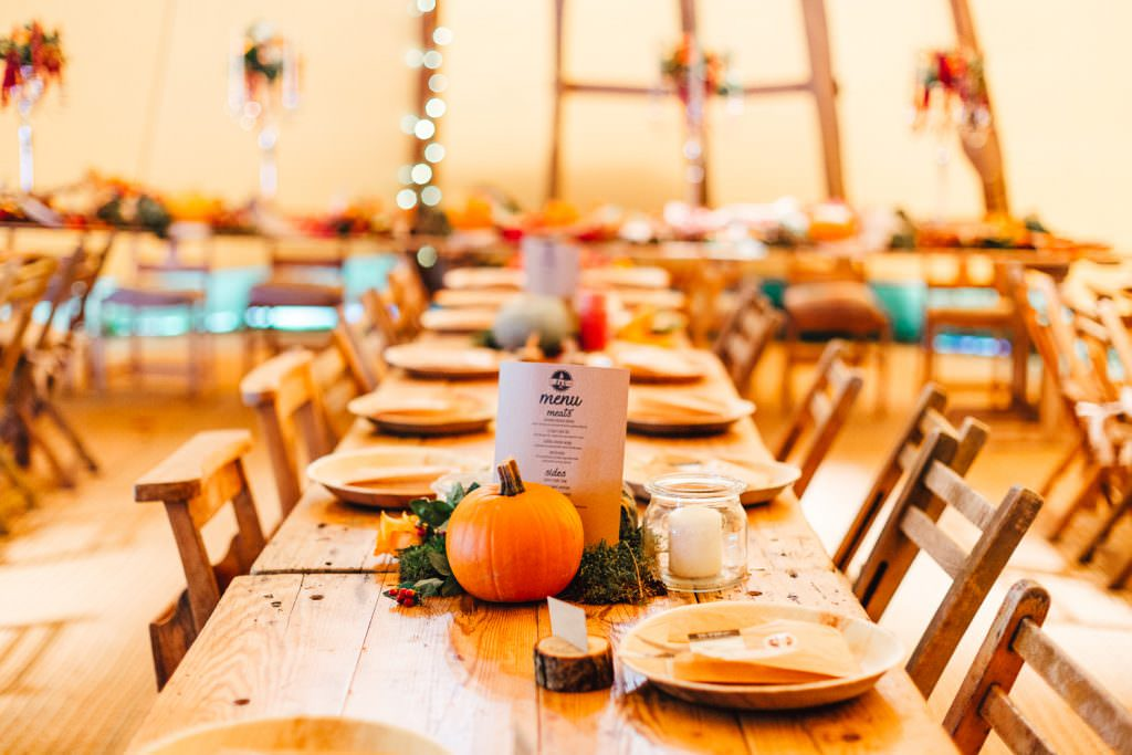 autumnal tipi table decor with pumpkins during the dreys wedding photography