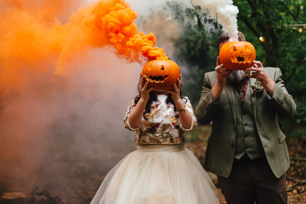 alternative couple portraits with pumpkins and smoke grenades, taken during the dreys wedding photography