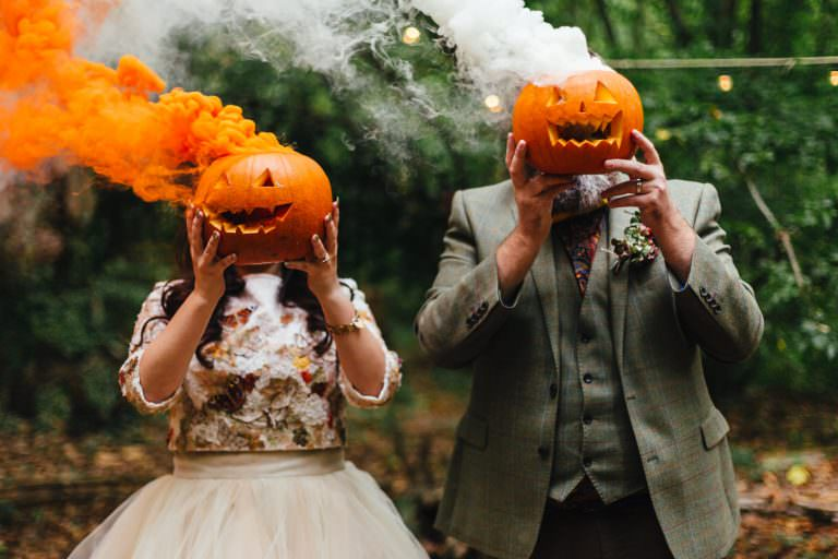colourful creative couple portraits with pumpkins and smoke grenades, taken during the dreys wedding photography