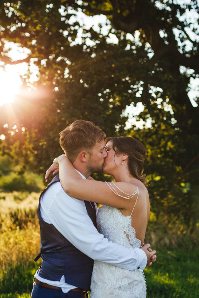 Natural couple photos at golden hour. Shot at Bower Hill Farm in Surrey during Colourful, Natural Festival Wedding Photography