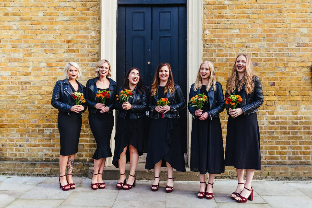 cool bridesmaids with black dresses and biker leather jackets at London Asylum and Battersea Arts Centre Wedding
