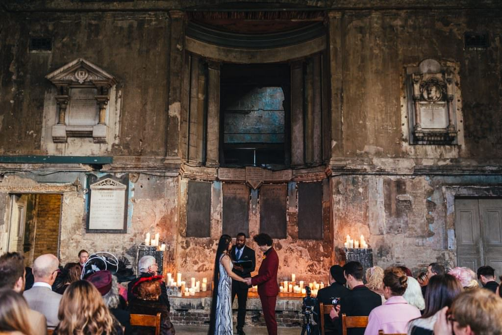 Gothic wedding ceremony with quirky details at Asylum and Battersea Arts Centre Wedding