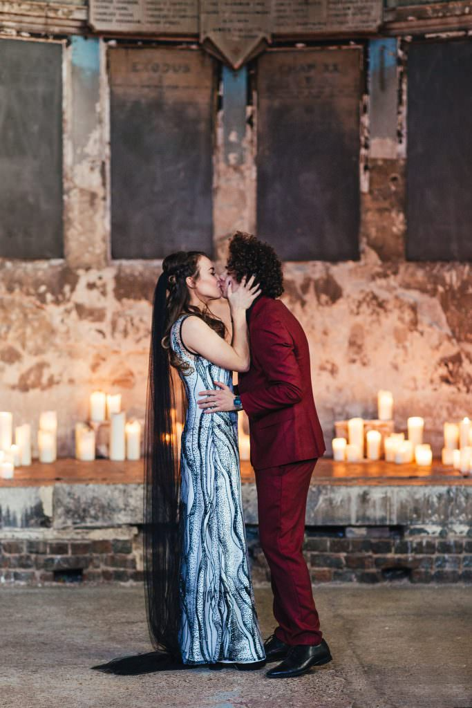 DIY gothic handmade wedding dress and red suit at Asylum and Battersea Arts Centre Wedding
