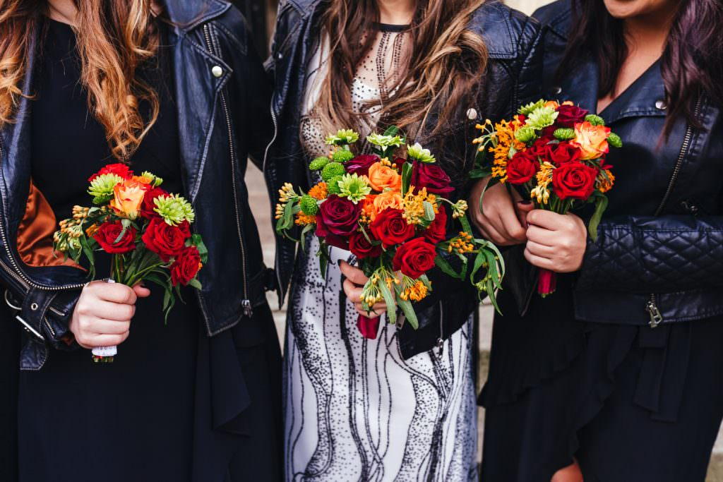 colourful wedding bouquets with black dresses and biker leather jackets at London Asylum and Battersea Arts Centre Wedding