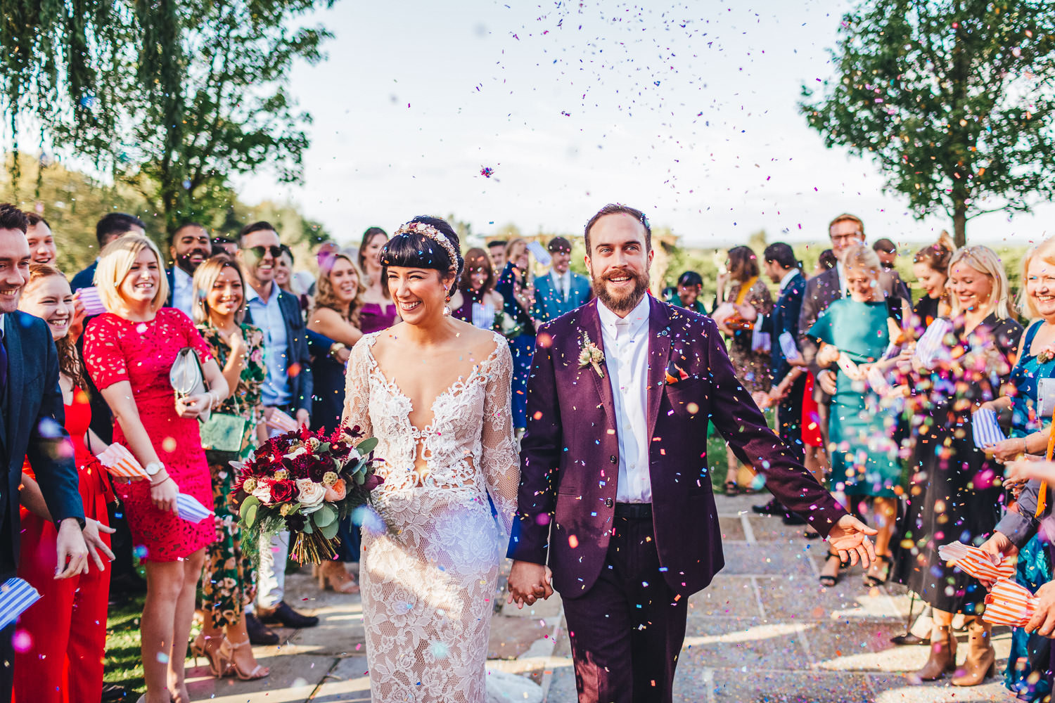Colourful and happy wedding confetti ideas during Alternative Cain Manor Wedding Photography