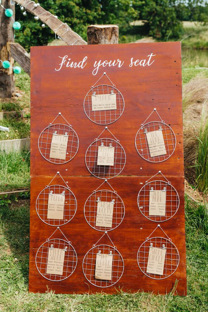 glastonbury inspired table settings Glastonbury Festival Themed West Sussex Wedding Photography on wooden sign