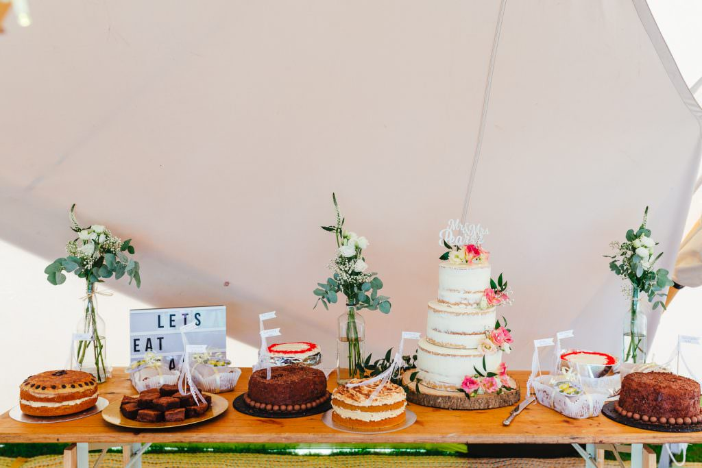 dessert table at wedding inspo glastonbury inspired table settings Glastonbury Festival Themed West Sussex Wedding Photography
