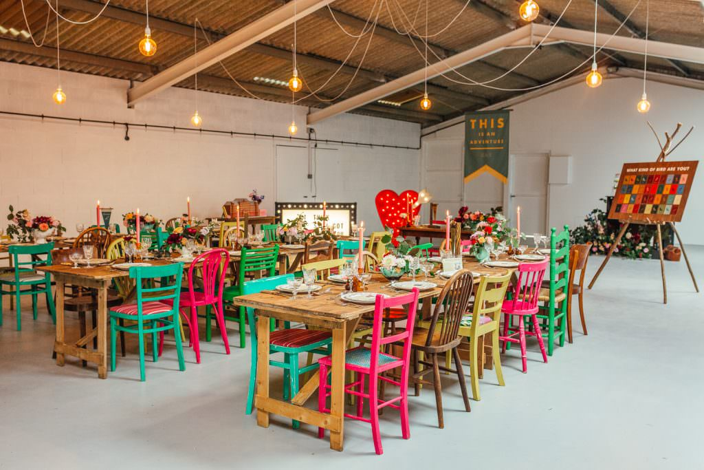 Eclectic mix of colourful mismatched chairs for a wes anderson inspired wedding