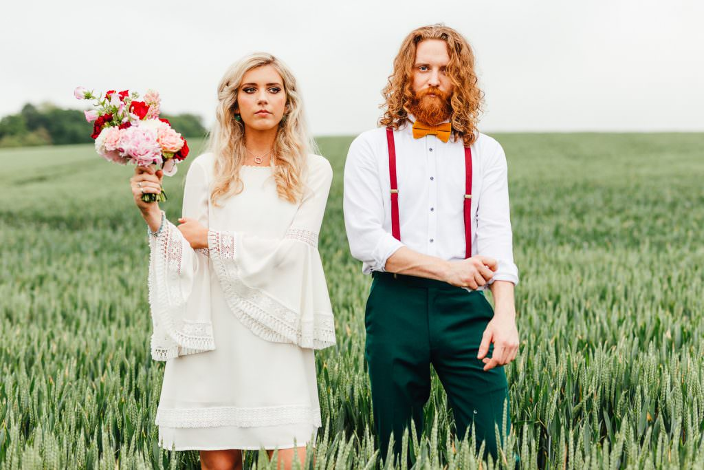 Bride and groom in 70s vintage attire inspired by Wes Anderson Moonrise Kingdom with Indie Brides dress