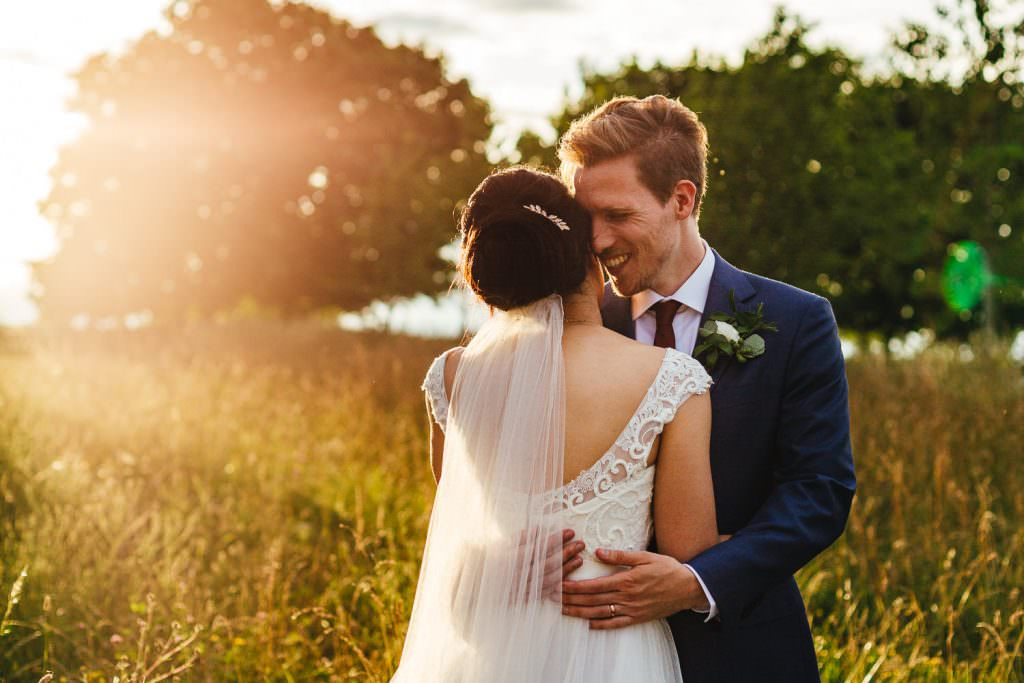 Couple smiling in golden hour during Cripps Stone Barn Wedding Photography portraits