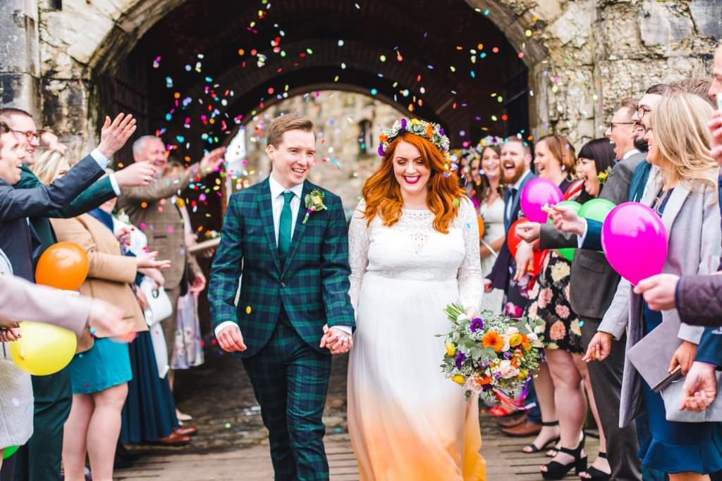 Very colourful confetti shot with bride in Lucy can't dance dip dye dress shot by Kirsty Mackenzie Fun creative hampshire wedding photographer