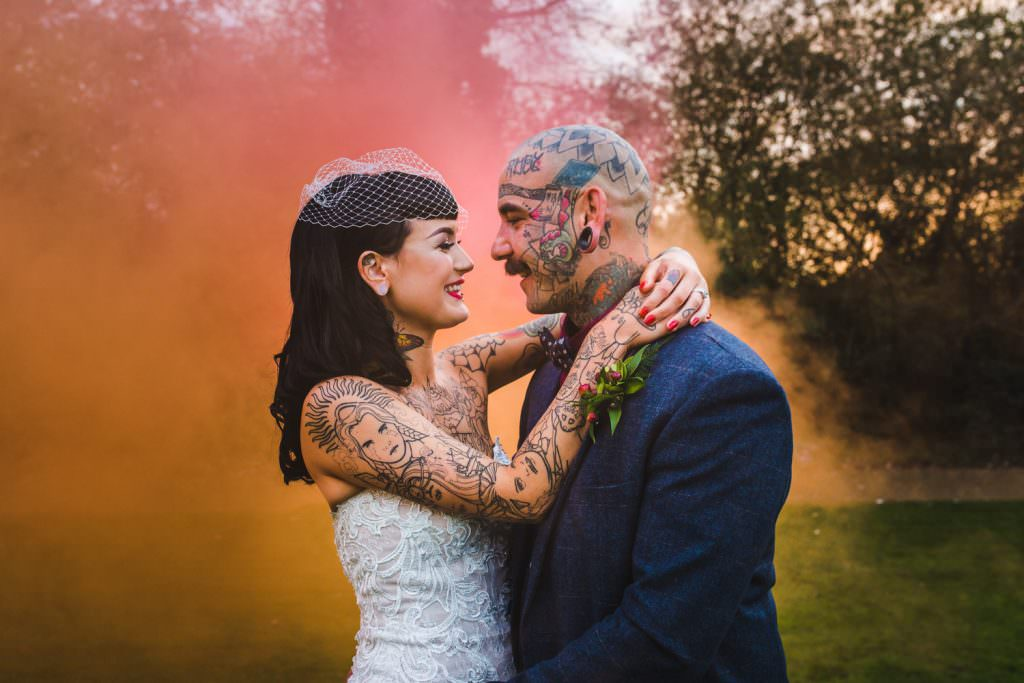 heavily tattooed bride and groom with alternative wedding fashion, captured by Kirsty a Fun creative hampshire wedding photographer