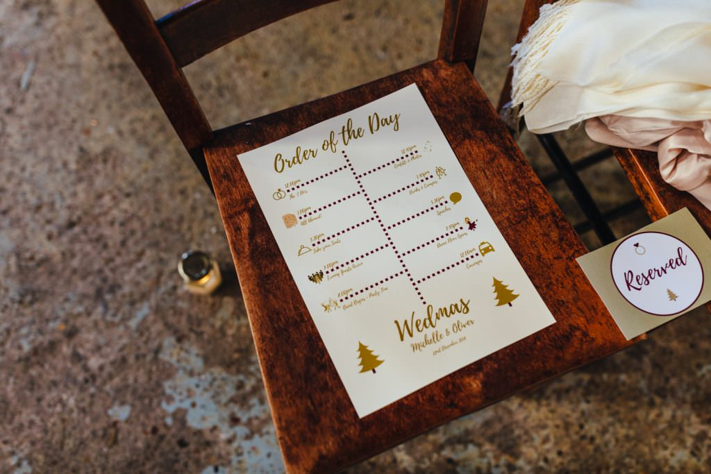 Christmas inspired order of the day wedding stationery during Christmas Inspired Winter Wedding at the Asylum