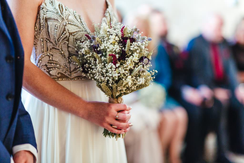 Awesome autumnal winter dried flowers bouquet at Christmas Inspired Winter Wedding at the Asylum