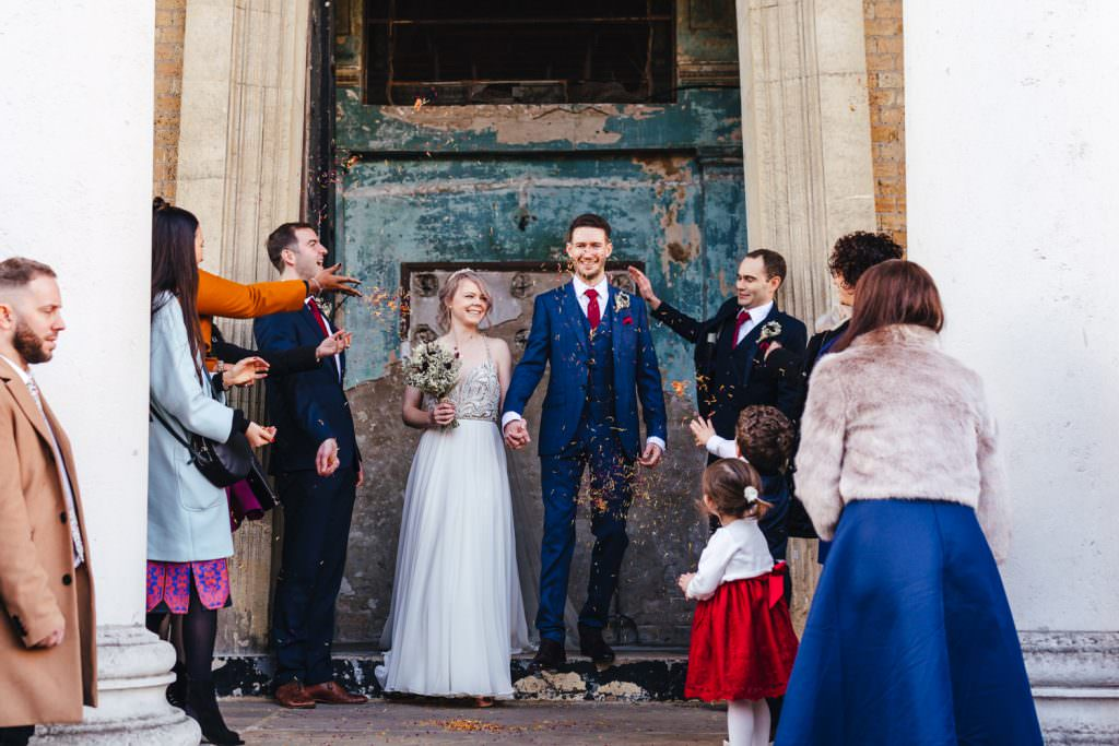 Bride and groom in confetti moment at Christmas Inspired Winter Wedding at the Asylum