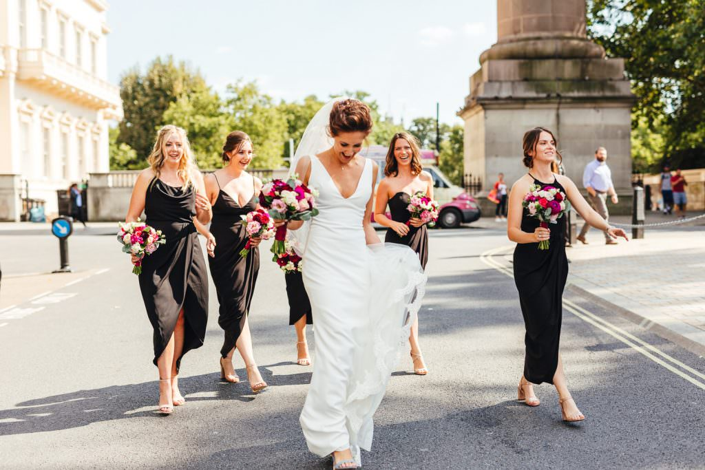 Bride in Made with Love wedding dress and bridesmaids in black mismatched dress during Stylish Fun & Natural Institute of Contemporary Arts Wedding Photography