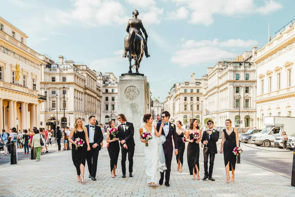 Wedding party with Pall Mall in the background during Stylish Fun & Natural Institute of Contemporary Arts Wedding Photography