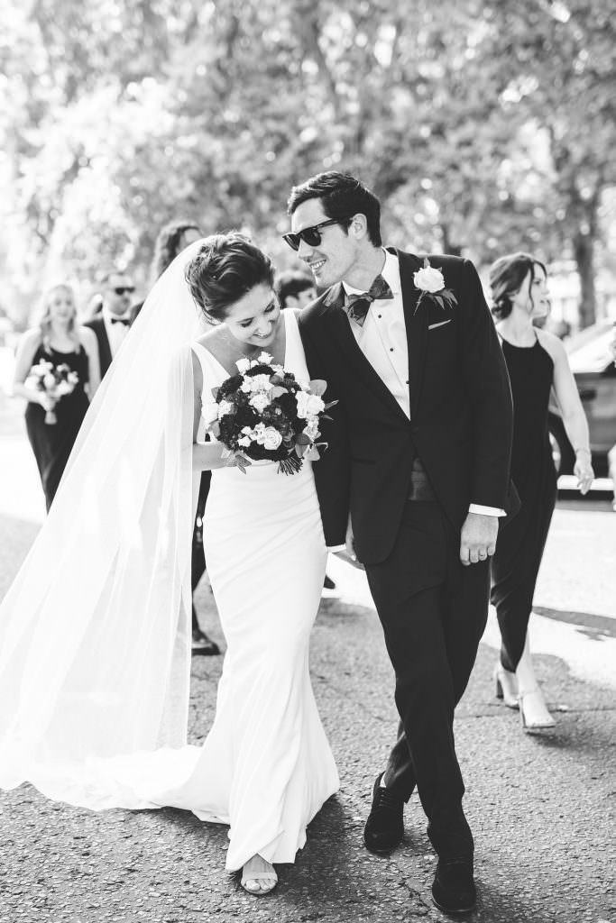 Bride and groom naturally laughing together during Stylish Fun & Natural Institute of Contemporary Arts Wedding Photography. Bride wears made with love and groom wears beggars run suit
