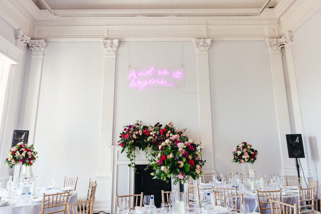 Neon sign decor for stylish London wedding taken during Stylish Fun & Natural Institute of Contemporary Arts Wedding Photography