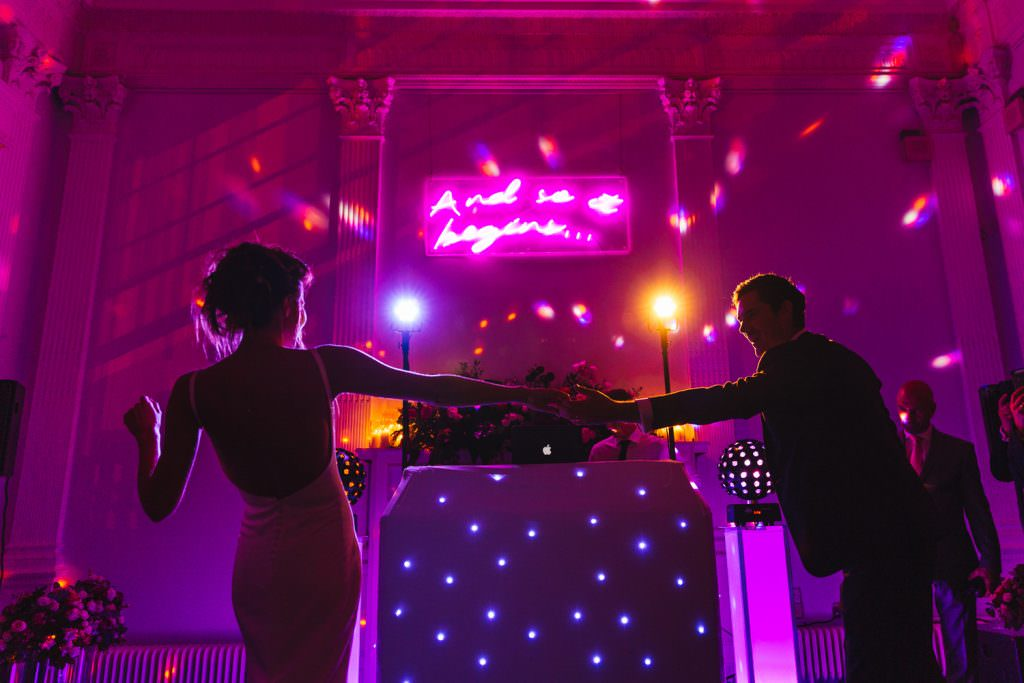 Neon decor wedding sign during first dance at wedding taken at Stylish Fun & Natural Institute of Contemporary Arts Wedding Photography