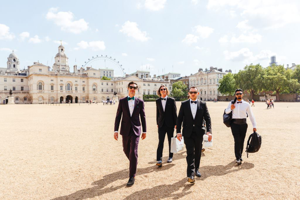 Groomsmen walking in London on wedding day at Stylish Fun & Natural Institute of Contemporary Arts Wedding Photography