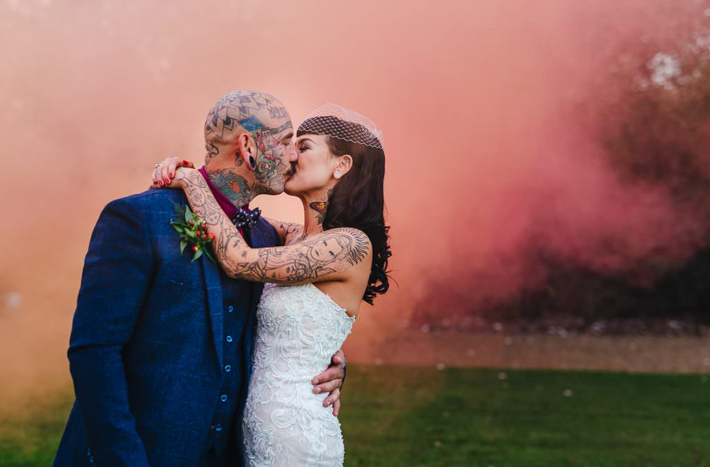 bride and groom with smoke bombs at Vintage Rockabilly meets Peaky Blinders Inspired Wedding in Hertfordshire