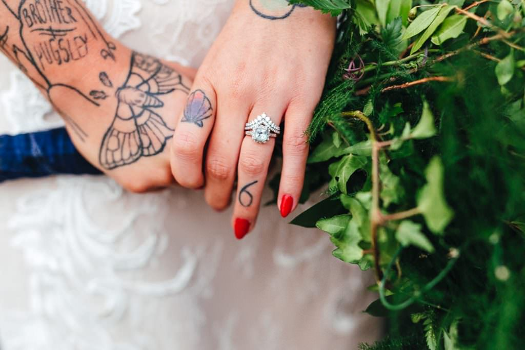 Alternative diamond wedding ring on tattooed bride at Vintage Rockabilly meets Peaky Blinders Inspired Wedding in Hertfordshire