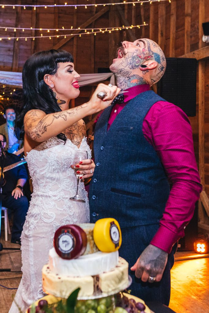 Alternative gothic cut the cake photo during Vintage Rockabilly meets Peaky Blinders Inspired Wedding in Hertfordshire
