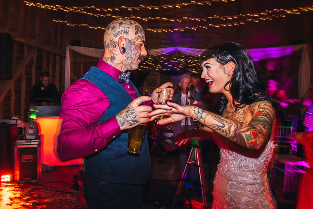 Tattooed couple at Vintage Rockabilly meets Peaky Blinders Inspired Wedding in Hertfordshire