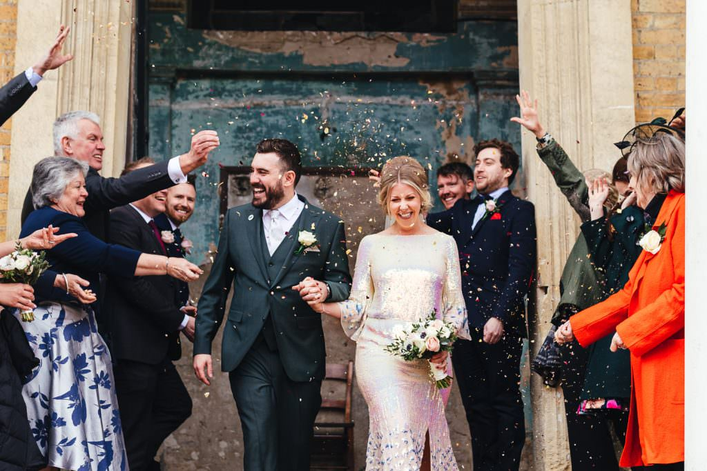 confetti at Asylum wedding photography. Bride wears sequin wedding dress by temperley bridal