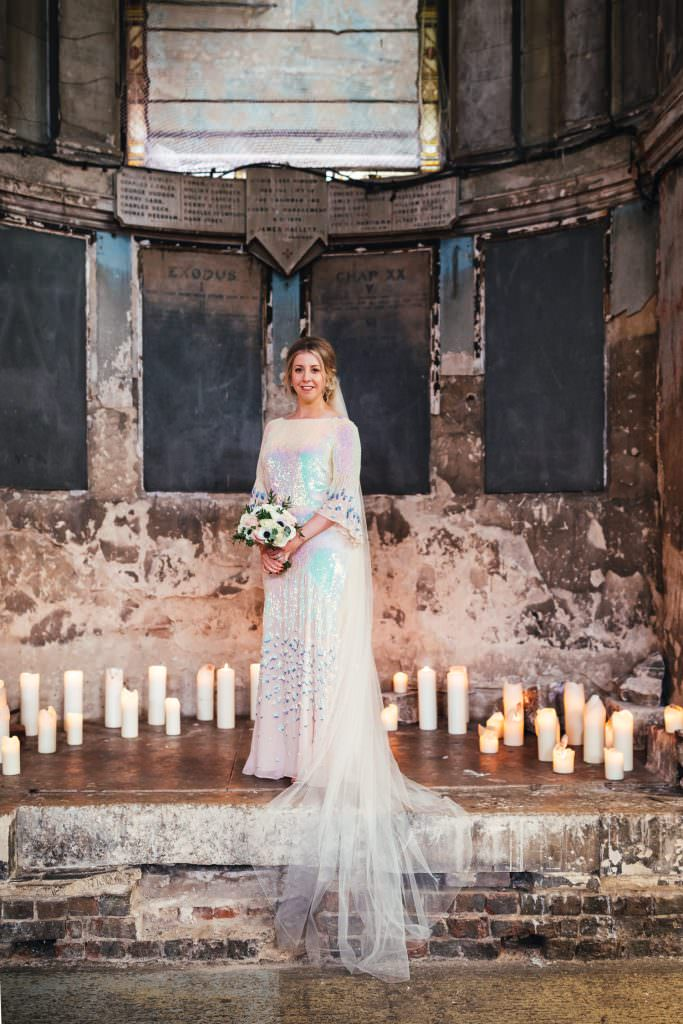 Bridal portrait in the asylum chapel. Asylum wedding photography. Bride wears temperley sequin wedding dress.