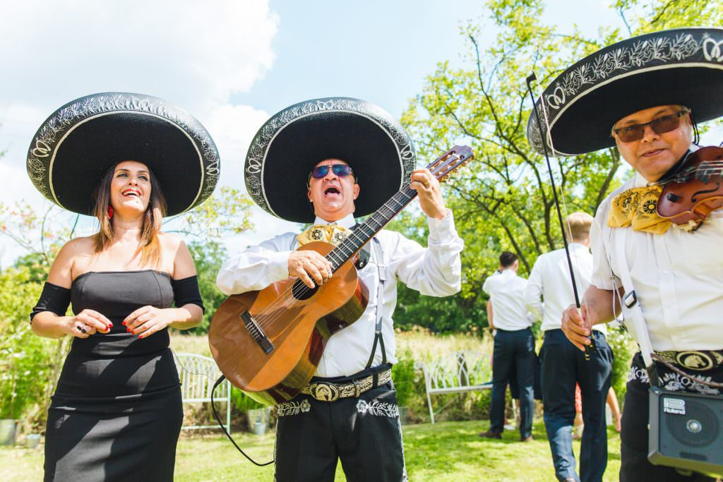 mariachi band playing during fun Sussex festival wedding photography.