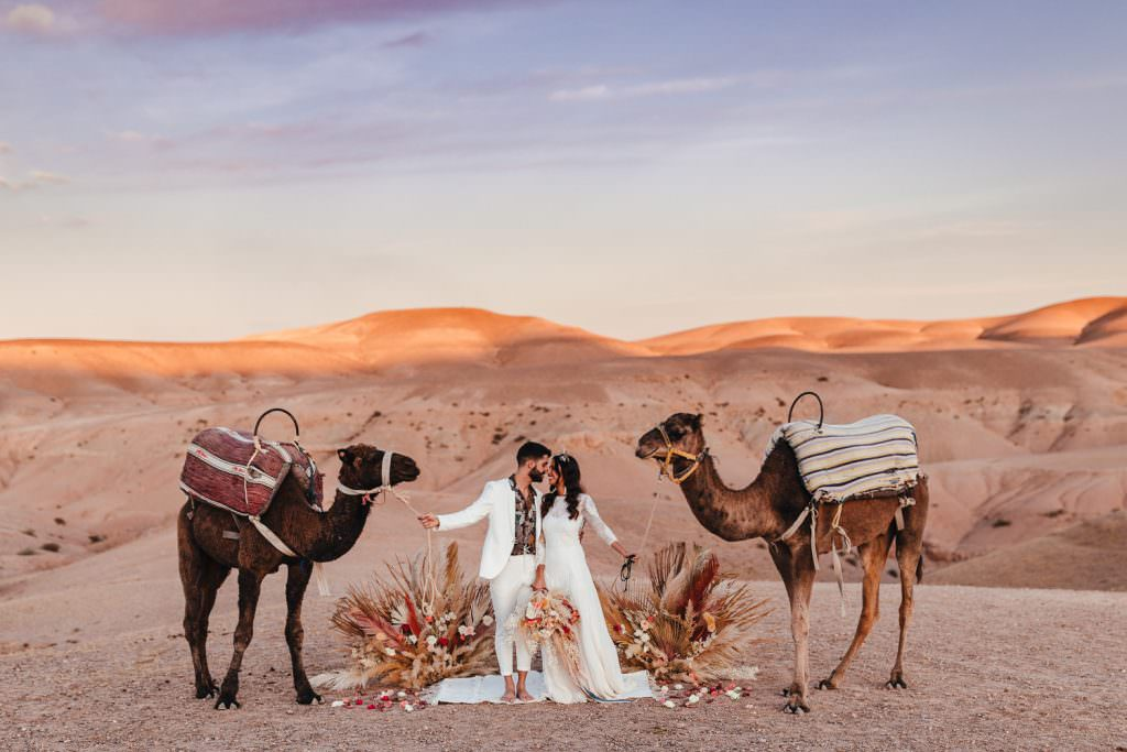 Bride and groom's wedding with camels during Wedding Photography in Agafay Desert Morocco