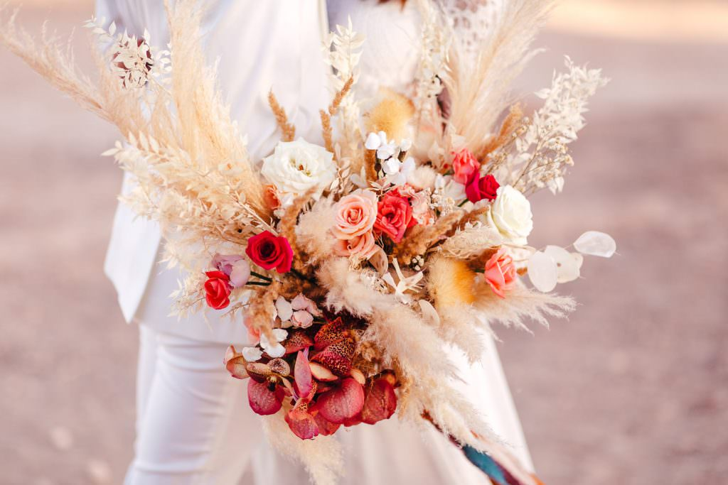 Wedding bouquet during Wedding Photography in Agafay Desert Morocco. Florals by AK weddings