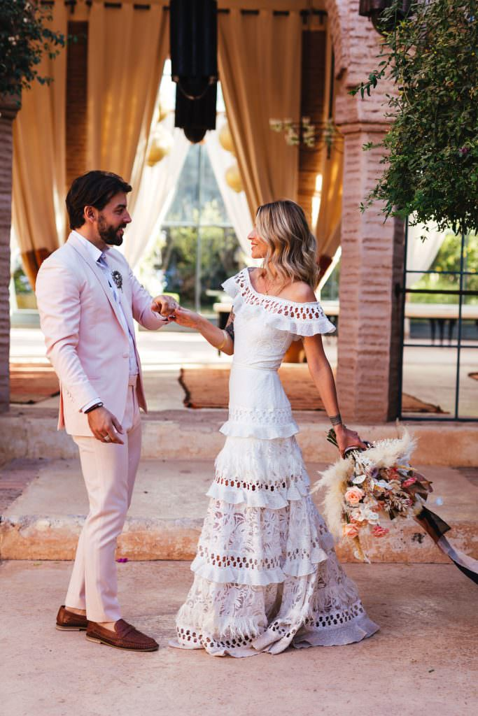 bride wears grace loves lace boho dress and dances with groom at Beldi Country Club Wedding Morocco