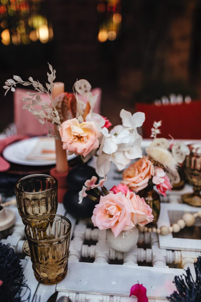 Black and pink table setting at  Beldi Country Club Wedding Morocco. Persian Rugs and Boho Fashion