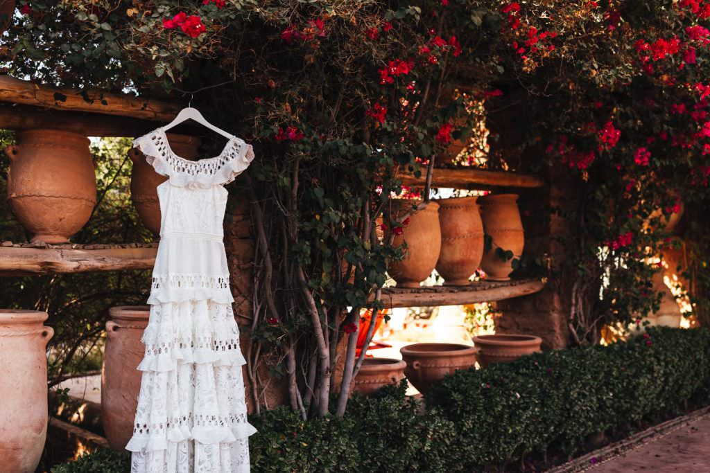 Grave loves lace wedding dress hanging up at Beldi Country Club Wedding Morocco