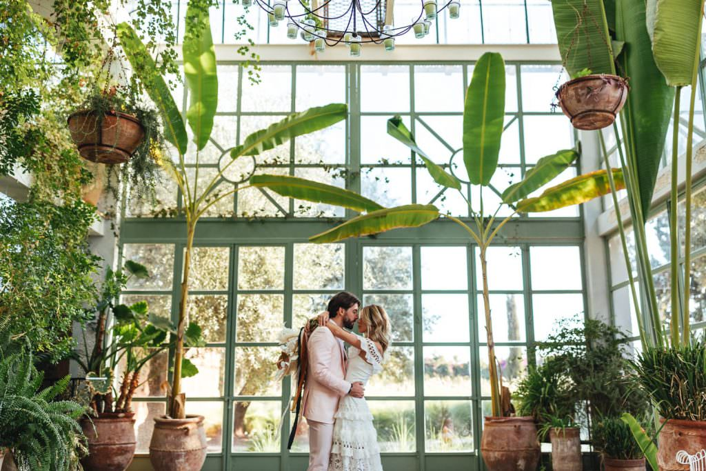 Bride and groom in greenhouse during Beldi Country Club Wedding Morocco