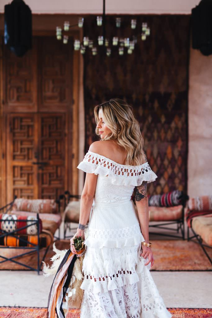 Bride in grace loves lace dress at Beldi Country Club Wedding Morocco Persian Rugs and Boho Fashion