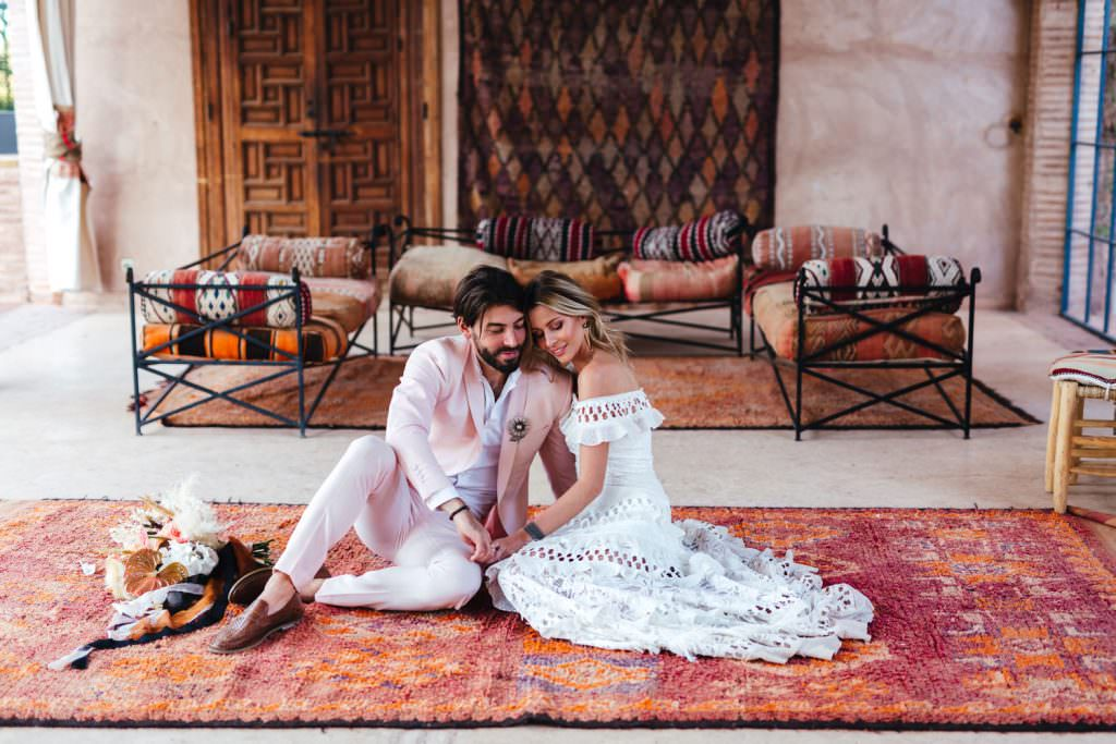 Bridal and groom natural couple photos in grace loves lace dress at Beldi Country Club Wedding Morocco. Persian Rugs and Boho Fashion