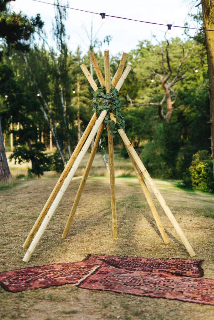 Chill out area with home made tipi during during Brook Farm Festival Wedding Photography in Hertfordshire. Design by watters bohemian wedding dress